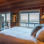 Cabin 2 bed across from windows with ocean view