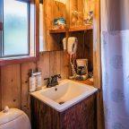 Sink by shower curtain in pristine Cabin 3 bathroom
