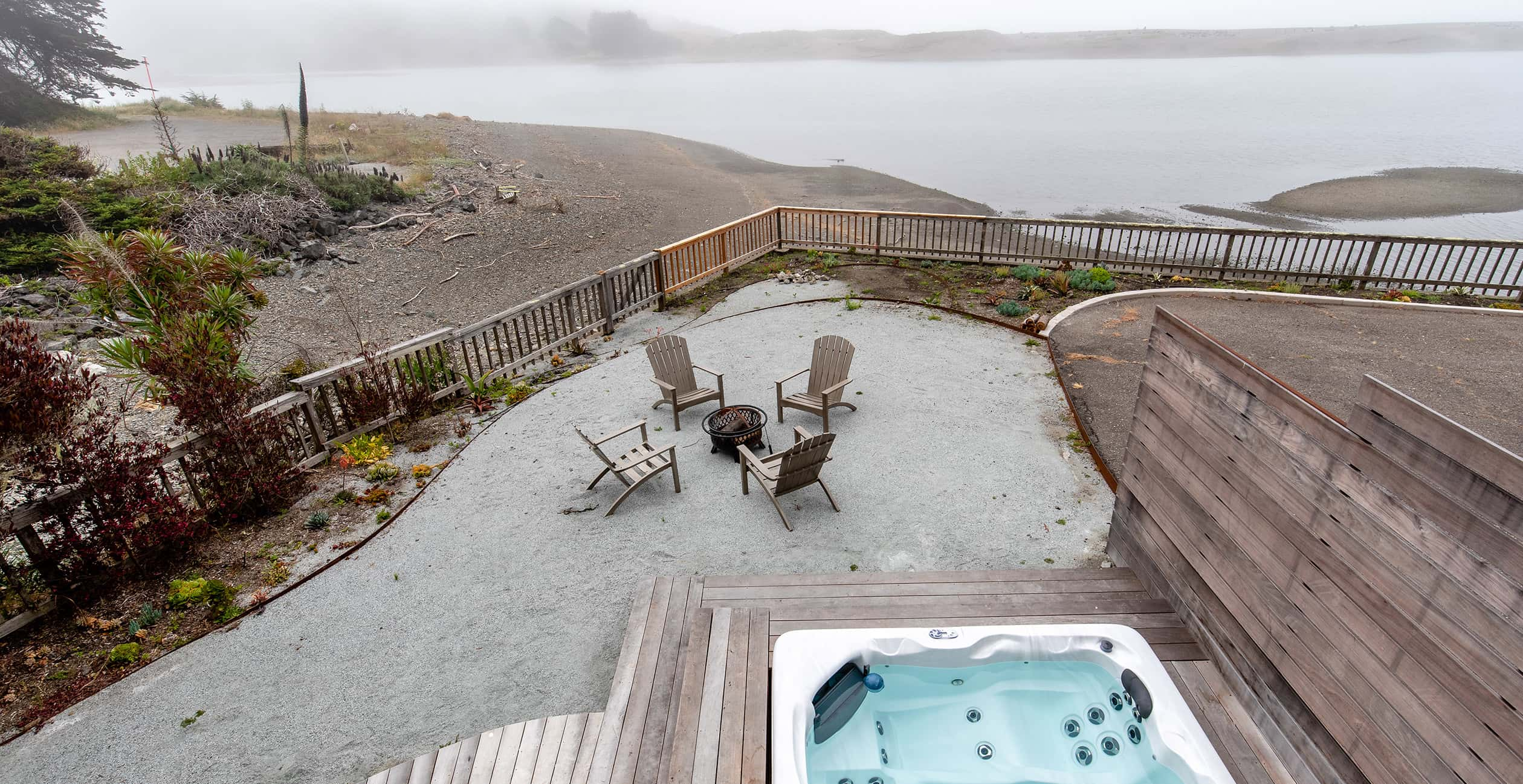 Sunset House fire pit and hot tub overview