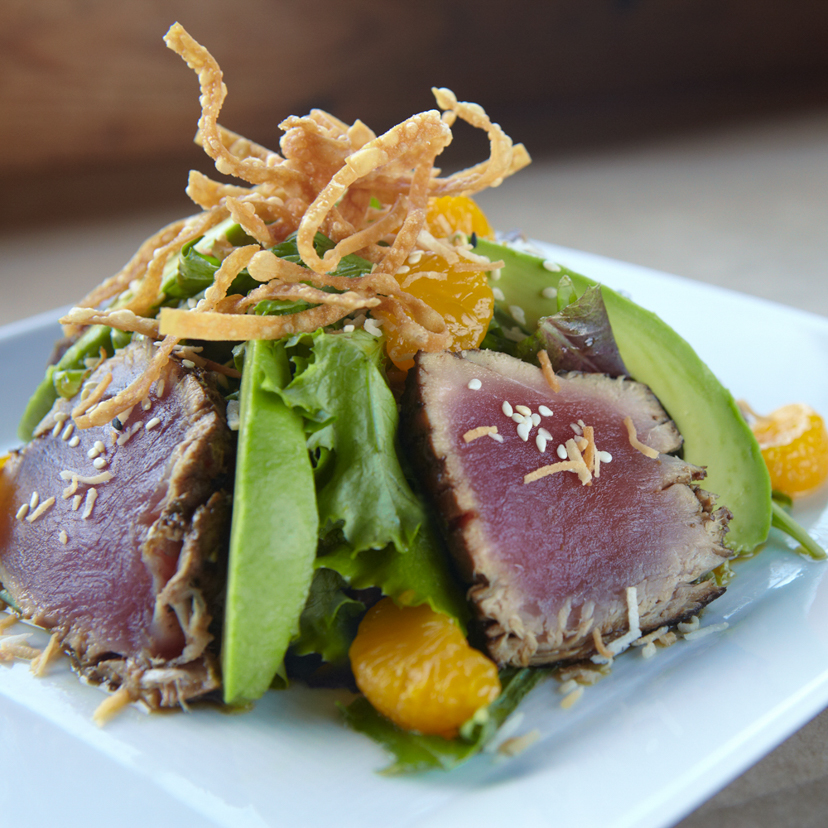 Seared ahi salad garnished with crisps and avocado served at our Sonoma County restaurant