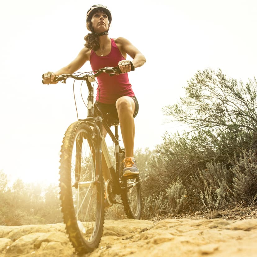 Woman riding a mountain bike on a trail