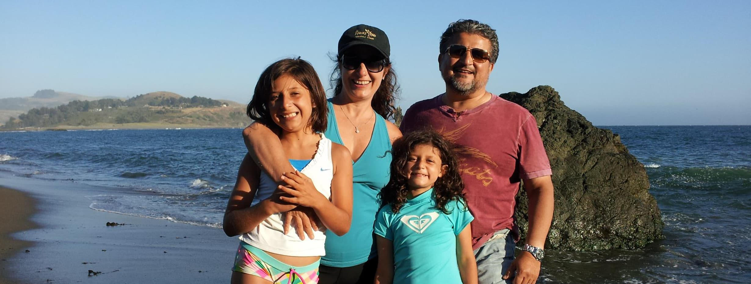 The Rangel family on a beach in California