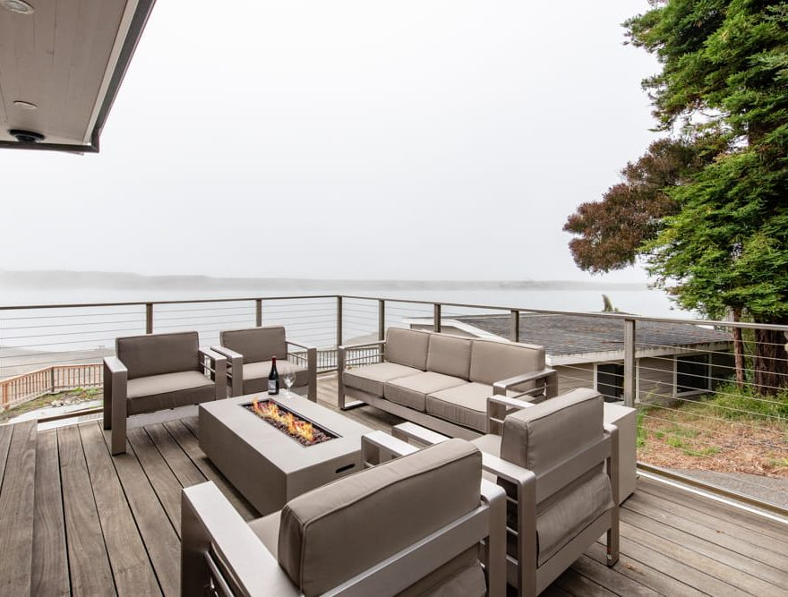 Fire pit and seating on a deck outside the Sunset House
