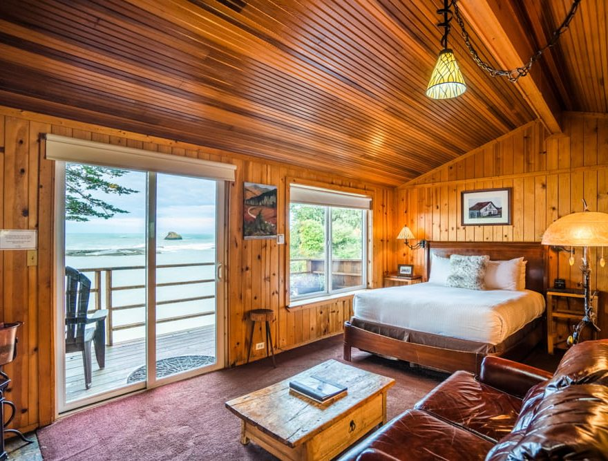 Queen bed in a cabin with a private deck